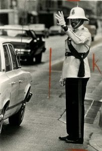 Photograph Lawrence Harrison directing Dallas traffic, May 1975