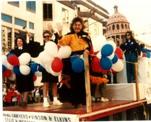 Paula Waddle in judge's robes on stage in Austin