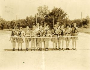 Girl Scouts playing tennis, undated