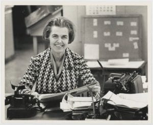 Vivian Castleberry, Dallas Times Herald women's editor, seated at a desk.