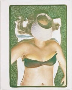 Visor, 1977, Photograph of the upper body of a sunbathing woman with her head covered by a visor.