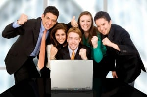 Business success team in an office in front of a laptop computer