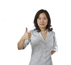 Asian women with thumb up in business causal clothing on white background