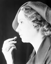 Mrs. Keegan putting on lipstick, ca. 1930s, by Robert Yarnall Richie