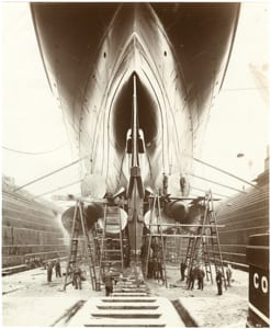 Stern view of Lusitania on stocks showing the propellers and launching cradle]