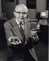 [Jack Kilby holding microchips and the first Cal-Tech calculator presented to Patrick E. Haggerty on March 29, 1967]