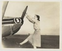 [Female Pilot Pulling on Airline Propeller], ca. 1944, DeGolyer Library, SMU.