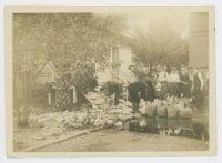 [Men Dumping Liquor at U.S. Customs House], ca. 1920, DeGolyer Library, SMU.