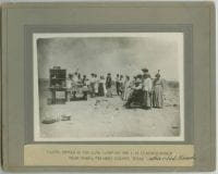 Eating Dinner in the Cow Camp on the L. H. Claunch Ranch near Marfa, Presidio County, Texas, ca. 1910s, DeGolyer Library, SMU.