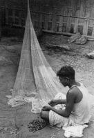 [Indian Man Repairing Fishing Net], 1945, DeGolyer Library, SMU.