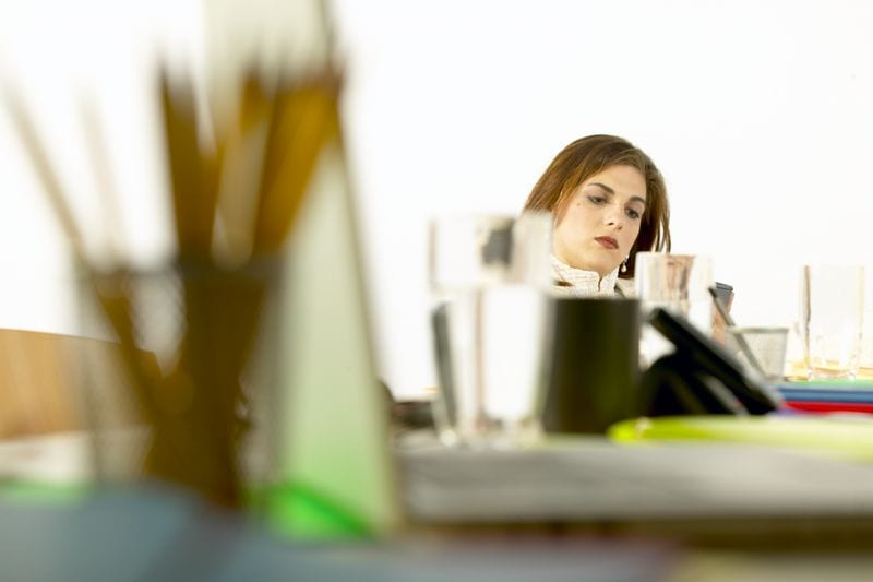 woman at desk thinking