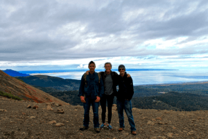 Casey Brokaw, Madie Jones and Ben Phrampus overlooking Cook Inlet in Anchorage, Alaska