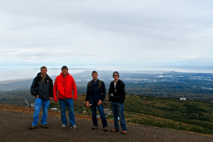 Matt Hornback, Rob Harris, Casey Brokaw and Ben Phrampus overlooking Cook Inlet in Anchorage, Alaska