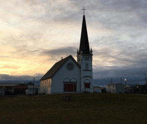 Old Saint Joseph's Church in Nome, AK at sunrise. One of the oldest buildings in Nome (1901) the church would light up at night in order to guide in wayward land travelers during the gold rush.