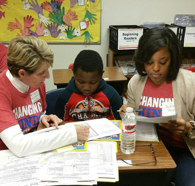 Stem School In Dallas: Simmons Volunteers With Reading Partners For Service Day