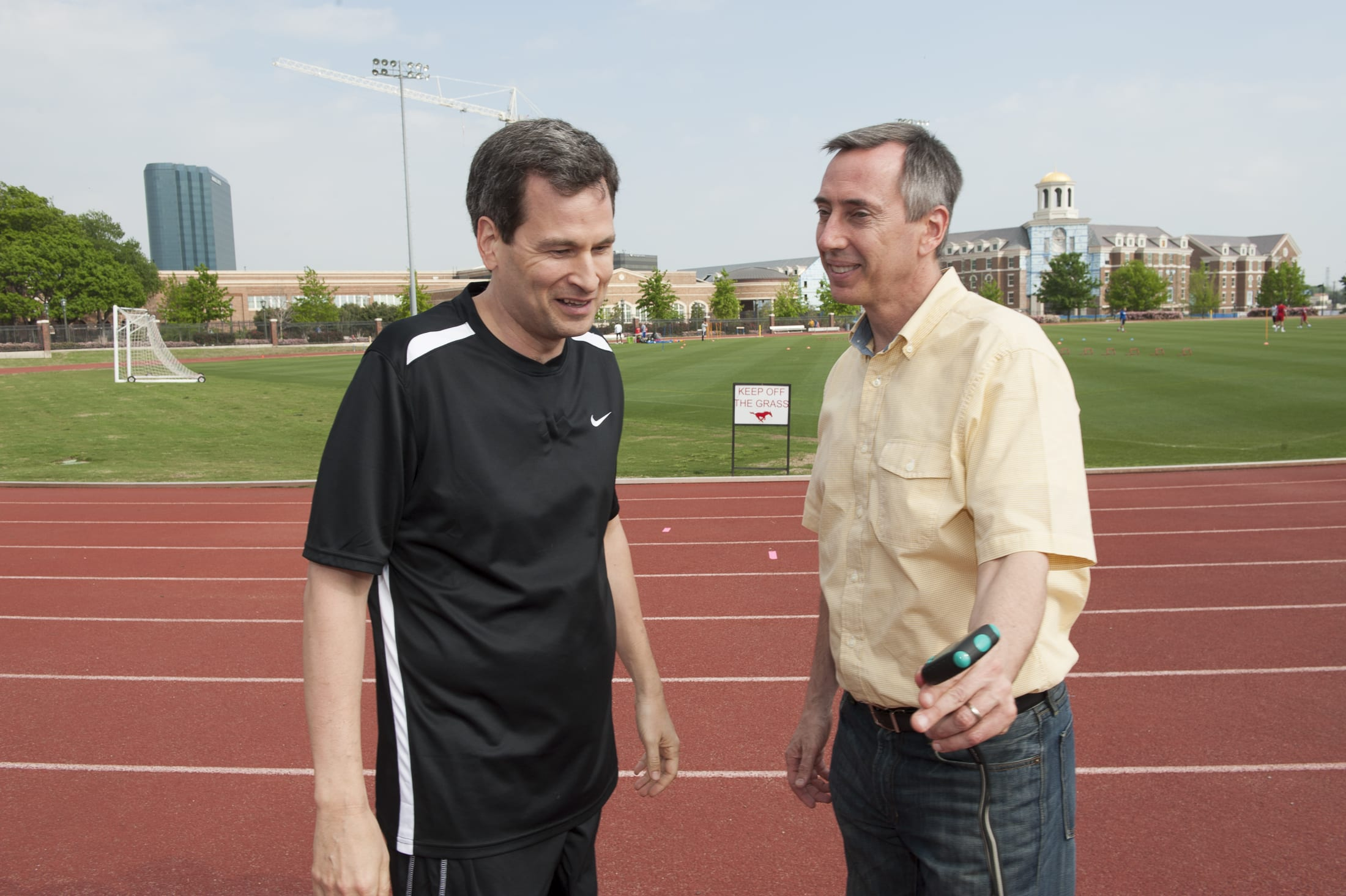 Peter Weyand (right) trackside at SMU