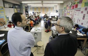 In a March 3, 2011 photo, teacher Josh Krinsky, left, and Principal Brett Kimmel get together in Krinsky's Global History class at the Washington Heights Expeditionary Learning School in New York. (AP Photo/Richard Drew)