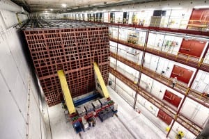 The completed NOvA far detector in Ash River, Minnesota, stands 50 feet tall, 50 feet wide and 200 feet long. The pivoting machine that was used to move each block of the detector into place now serves as the capstone on the end of the completed structure. Photo: Fermilab