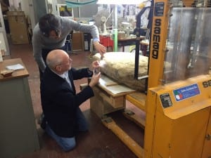 Scientists examine the Etruscan stele, weighing about 500 pounds and nearly four feet tall by more than two feet wide. (Credit: Mugello Valley Project)