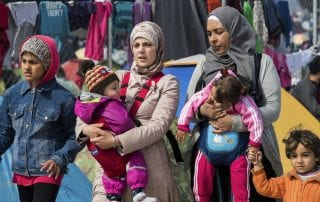 Women and children in refugee camp in Greece