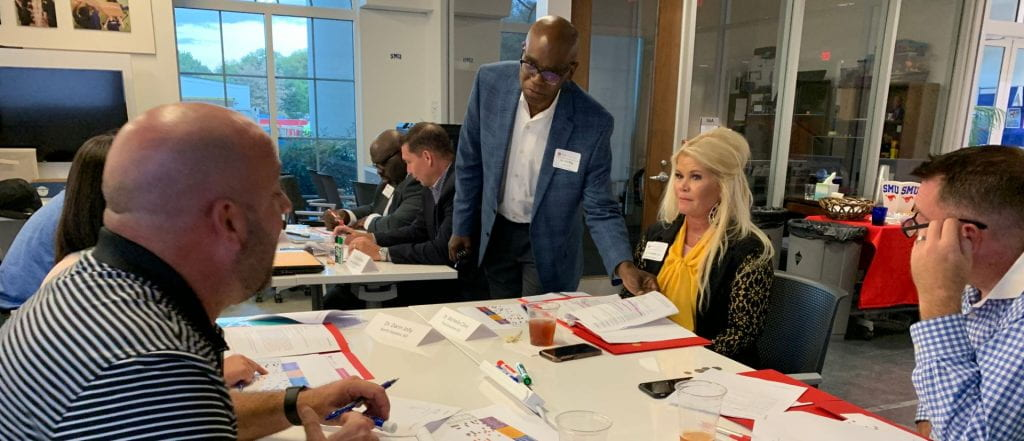 Superintendents work with Dr. Eric G. Bing during a leadership strengths session.