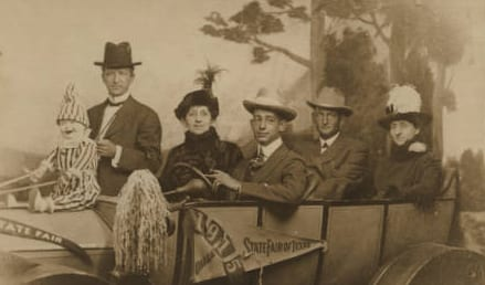 Five People in a Touring Car Prop with 1915 State Fair of Texas in Dallas Banner