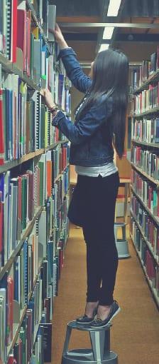 Woman grabbing a book