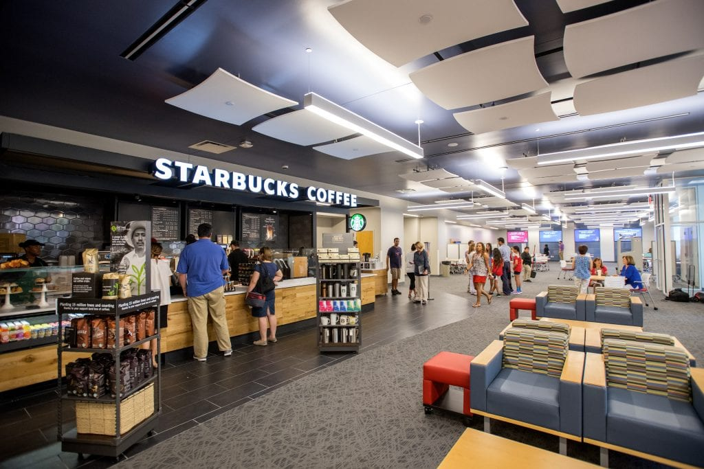Patrons enjoy the new Collaborative Commons and Starbucks in Fondren Library.