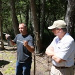 Bob talks about his orchid conservation research at the Ridges Sanctuary with Chancellor Gary Miller standing by.