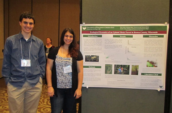 Sara Smith and Austin Carter with their poster at the WiscAMP  conference in Madison, WI.