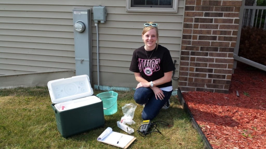 Amanda Hamby collecting water samples from a home in northeastern Wisconsin.