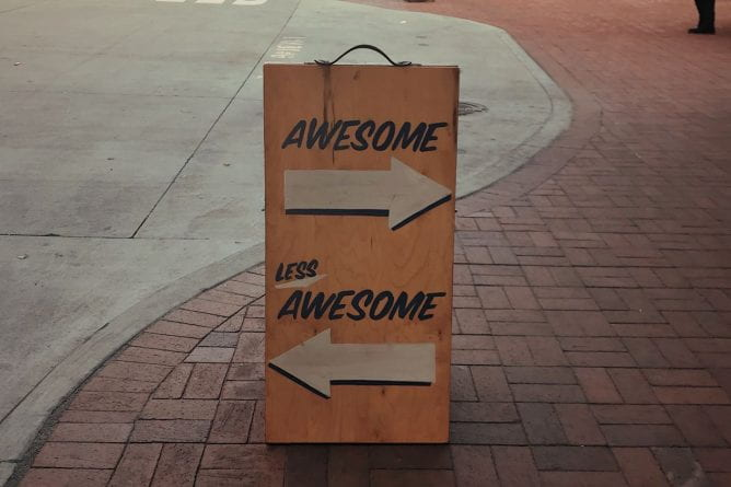 "A sign pointing one way to ""awesome"" and the other to ""less awesome"""