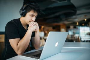 Image of person wearing headphones joining a web meeting on a laptop