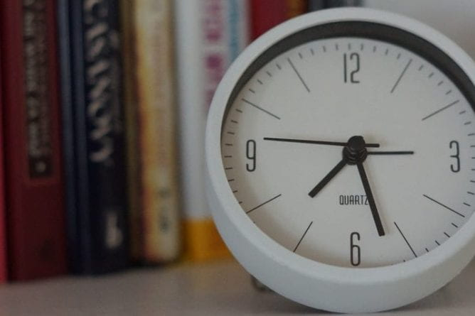 A clock with books.