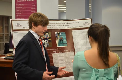 Students presenting at a poster session