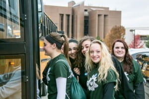 Volunteers loading buses for UWGB Make a Difference Day
