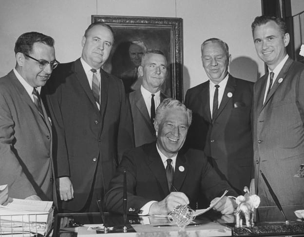Gov Warren Knowles signing UWGB billl 9-2-65