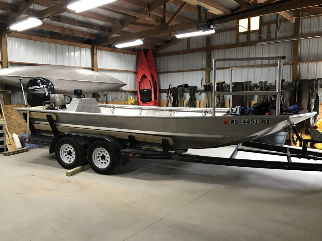 20 ft Aluminum work boat with 90 hp outboard for medium to large water bodies.