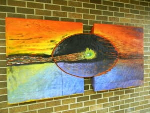 """Cycle"" by Prof. Kristy Deetz. Encaustic and carved wood with silver solder. Location: 3rd floor, near circulation desk."