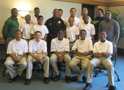 Phoenix Scholars and mentors, above, with Officer Solomon Ayres