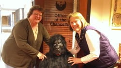 Chancellor's Office staff, Paula Marcec and Becky Ouradnik, pose with gorilla-suit-clad Emily Rogers