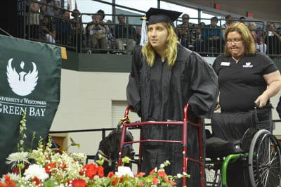 Grad achieves dual goals of earning diploma, walking to receive it