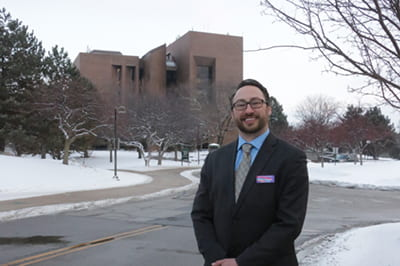 Brian Simons in front of the Cofrin Library.