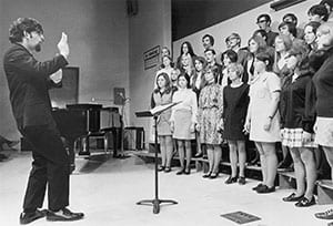 Prof. Trinidad Chavez, then UW-Green Bay's director of choral activities, rehearses with a 1970s-era student ensemble on campus.