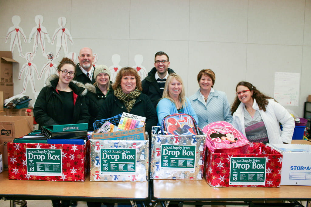 UWGB empoyees dropping off school supplies at Jefferson Elementary School