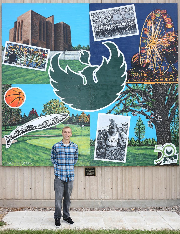 Uw green bay dedicates 50th anniversary mural inside uw for Mural go green