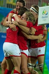 Lukan and Canadian Olympic teammates embrace