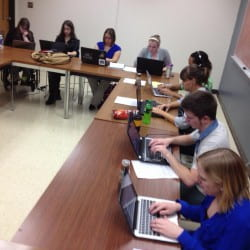 Students writing in TH378