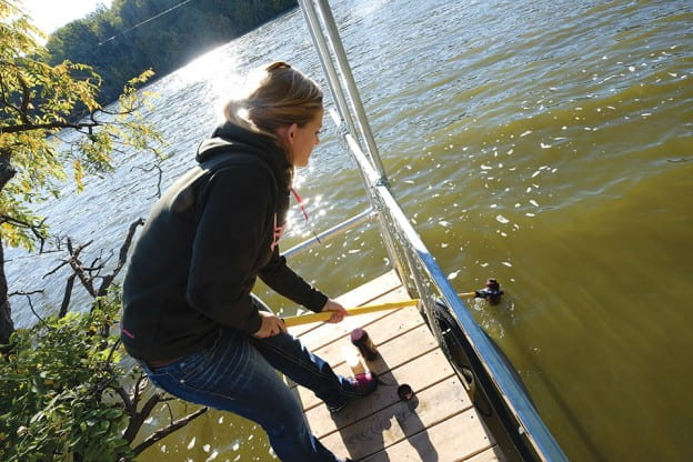Erica Muelmans taking a water sample
