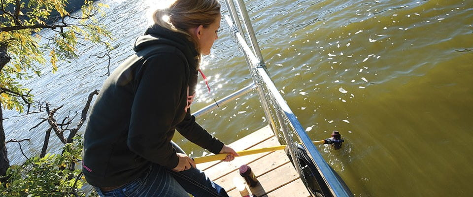 Erica Muelmans taking a water sample